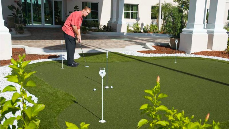 Perfect your golfing skills at our putting green - hotel entrance