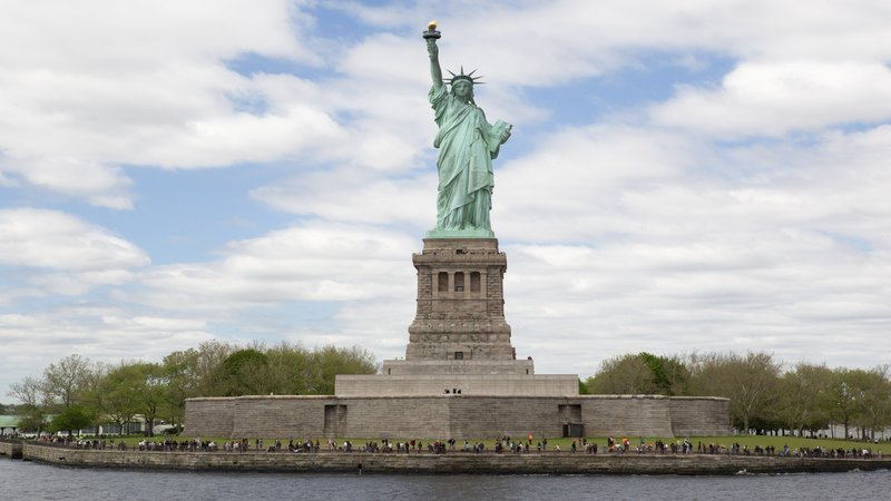 Walk to Battery Park to catch the ferry to the Statue of Liberty
