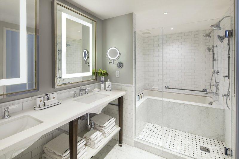 Deep Soaking Tub in Marble-Clad Bathroom