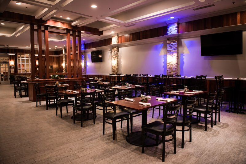 Embers Restaurant featuring spacious seating and TVs throughout