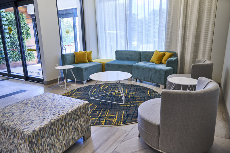 Enjoy our lobby seating at our Miami Airport Hotel