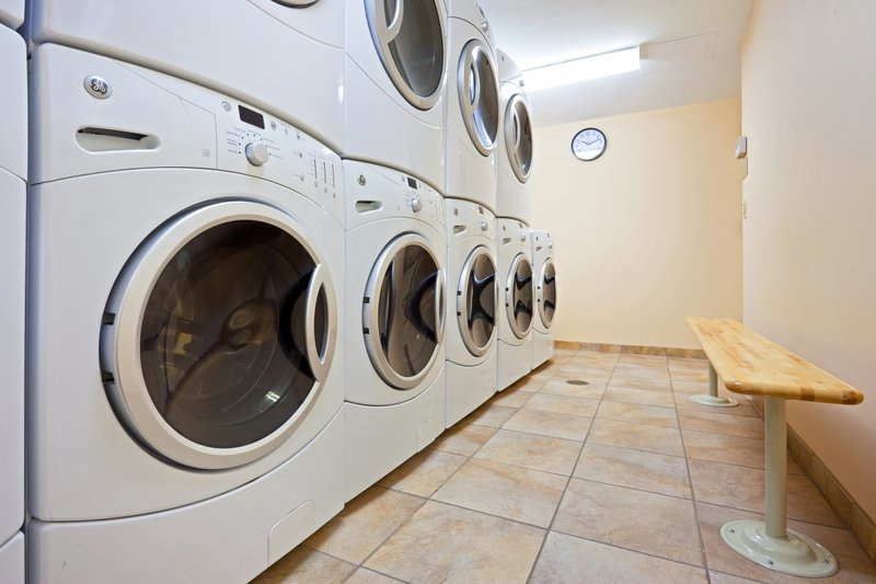 Enjoy the convenience of home with our 24hr laundry facility