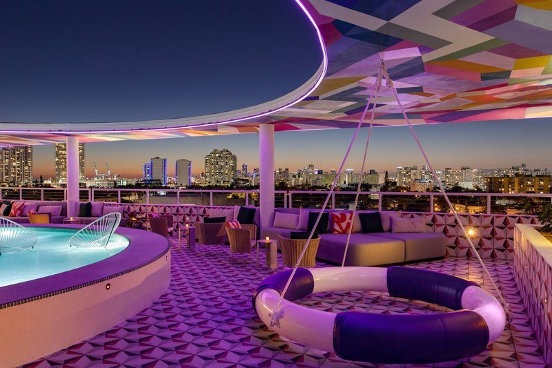 The Upside Rooftop Lounging Pool & Sitting Area